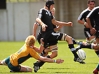 Blade Thomson kicks the ball ahead as Eddie Quirk's tackle is too late during the International rugby match between New Zealand Secondary Schools and Suncorp Australia Secondary Schools at Yarrows Stadium, New Plymouth, New Zealand on Friday, 10 October 2008. Photo: Dave Lintott / lintottphoto.co.nz