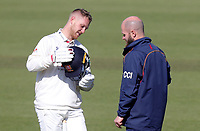Jamie Porter of Essex and the club physio Chris Clarke-Irons discuss where the ball hit his helmet during Surrey CCC vs Essex CCC, Specsavers County Championship Division 1 Cricket at the Kia Oval on 13th April 2019