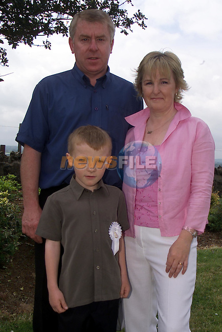 Anthony, Robert and Rita Tormey, pictured at Bellewstown church where Robert recieved his first holy communion..Picture: Arthur Carron/Newsfile