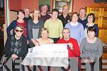 Christy Lehane, Kerry Friends of Motor Neurone pictured as he presented a cheque for ?18,000 to Marie Reavey, IMNDA in Darby O'Gills hotel, Killarney on Thursday night. Also pictured are Pat Carmody, Nora Murphy, Betty Carmody, Sheila Casey, Mary Lehane, Mery Reidy, Mary O'Leary, Paddy O'Keeffe, Tom MacDonnell, Batty O'Sullivan and Patsy Kelleher. .Picture: Ger Cronin (087) 0522010............................