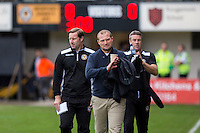 Newport County manager Warren Feeney heads to the dugout ahead of the Sky Bet League 2 match between Newport County and Cheltenham Town at Rodney Parade, Newport, Wales on 10 September 2016. Photo by Mark  Hawkins / PRiME Media Images.