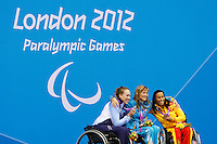 04.09.2012 London, England, Paralympic Swimming held at the Aquatics Centre. Women's 100m Breatstroke SB4 medalists, Sarah Louise Rung (NOR) silver, Nataliia Prologaieva (UKR) gold,Teresa Perales (SPN) bronze
