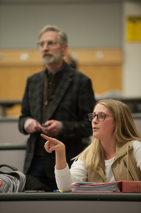 Student Lena Ratcliff answers a question asked by Professor John Petraitis, Associate Dean for Social Sciences, during Statistics for Psychology (PSY A260) in UAA's Social Sciences Building.