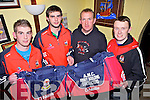 .Jermiah Moroney and Mike Lenihan from Mountcollins GAA receiving their new kit bags from Anthony Hartnett and Jack Lane(centre) from AMC Contractors, pictured here last Friday night in Tommy Micks Bar, Mountcollins.
