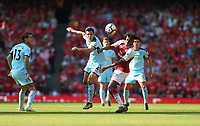 Burnley's Jack Cork and Arsenal's Alex Iwobi<br /> <br /> Photographer Rob Newell/CameraSport<br /> <br /> The Premier League - Arsenal v Burnley - Sunday 6th May 2018 - The Emirates - London<br /> <br /> World Copyright &copy; 2018 CameraSport. All rights reserved. 43 Linden Ave. Countesthorpe. Leicester. England. LE8 5PG - Tel: +44 (0) 116 277 4147 - admin@camerasport.com - www.camerasport.com