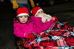 BETHLEHEM, CT. 07 December 2018-120718 - Brooklyn Tuz 2, and her sister Elizabeth 5, of Bethlehem are all snuggled up from the cold and are excited to see Santa during the annual Christmastown Festival on the Town Green in Bethlehem on Friday. Bill Shettle Republican-American