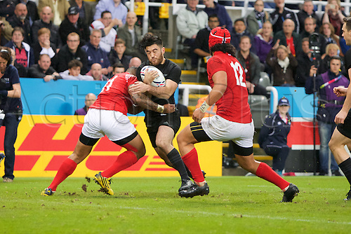 09.10.2015. St James Park, Newcastle, England. Rugby World Cup. New Zealand versus Tonga. New Zealand All Black wing Nehe Milner-Skudder is tackled by Tonga wing Fetu'u Vainikolo.