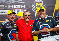 Jul 23, 2017; Morrison, CO, USA; NHRA team owner Don Schumacher (center) with crew members Mark Oswald (left) and Brian Corradi for top fuel driver Antron Brown celebrate after winning the Mile High Nationals at Bandimere Speedway. Mandatory Credit: Mark J. Rebilas-USA TODAY Sports