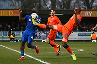 Tom Elliott of Millwall and Deji Oshilaja of AFC Wimbledon during AFC Wimbledon vs Millwall, Emirates FA Cup Football at the Cherry Red Records Stadium on 16th February 2019