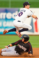 Lakewood BlueClaws shortstop Tim Carver (10) leaps over the sliding Michael Marjama (23) of the Kannapolis Intimidators as he turns a double play at FirstEnergy Park on August 8, 2012 in Lakewood, New Jersey.  The BlueClaws defeated the Intimidators 5-0.  (Brian Westerholt/Four Seam Images)