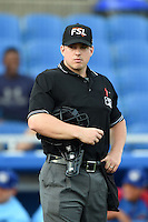 Home plate umpire Ryan Benson during a game between the Daytona Cubs and Dunedin Blue Jays on April 14, 2014 at Florida Auto Exchange Stadium in Dunedin, Florida.  Dunedin defeated Daytona 1-0  (Mike Janes/Four Seam Images)
