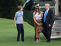United States President Donald J. Trump and First Lady Melania Trump hold hands as they walk across the South Lawn as they and their son Barron Trump, left, return to the White House in Washington, DC, after a trip to New Jersey, June 11, 2017. Photo Credit: Chris Kleponis/CNP/AdMedia