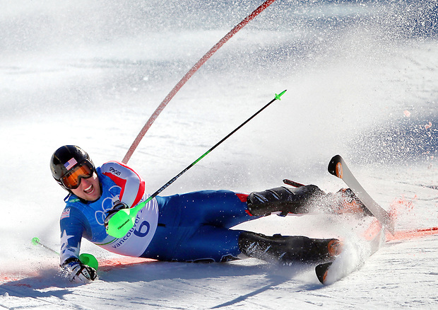 USA's Andrew Weibrecht crashes across the finish at the end of his slolom run in the men's super combined at the XXI Olympic Winter Games on Sunday, February 21, 2010 in Whistler, British Columbia.