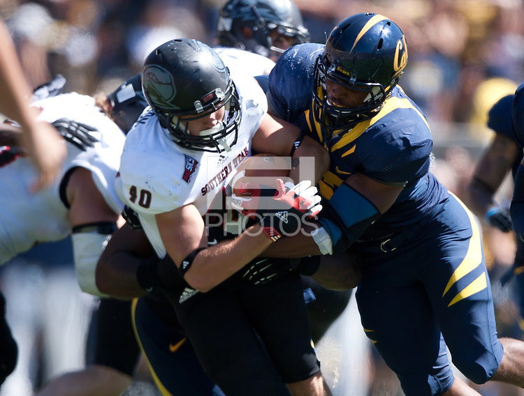 September 8, 2012: California's Brennan Scarlett tries to rip the ball off of Southern Utah's Rickey Clark during a game at Memorial Stadium, Berkeley, Ca