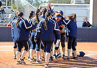 Florida International University players celebrate during the game against the University of Illinois.  FIU won the game 8-0 on February 12, 2012 at Miami, Florida. .