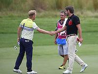 Robert Rock (ENG) shakes hands with Soren Kjeldsen (DEN) during Round Three of The Tshwane Open 2014 at the Els (Copperleaf) Golf Club, City of Tshwane, Pretoria, South Africa. Picture:  David Lloyd / www.golffile.ie
