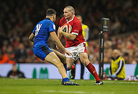 1st February 2020; Millennium Stadium, Cardiff, Glamorgan, Wales; International Rugby, Six Nations Rugby, Wales versus Italy; Ken Owens of Wales evades would be  tackler Leonardo Sarto of Italy
