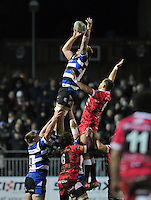 Dominic Day rises high to win lineout ball. Amlin Challenge Cup match, between Bath Rugby and Mogliano Rugby on December 14, 2013 at the Recreation Ground in Bath, England. Photo by: Patrick Khachfe / Onside Images