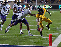 November 2nd, 2012: California's Chris Harper avoids being tackled by Washington's Marcus Peters and Chris Harper dives for a touchdown during a game against Washington at Memorial Stadium, Berkeley, Ca Washington defeated California 21 -13