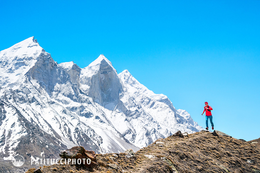 Trail running in the Indian Himalaya while on a trek to the Shivling area. In the background is Bhagarathi.