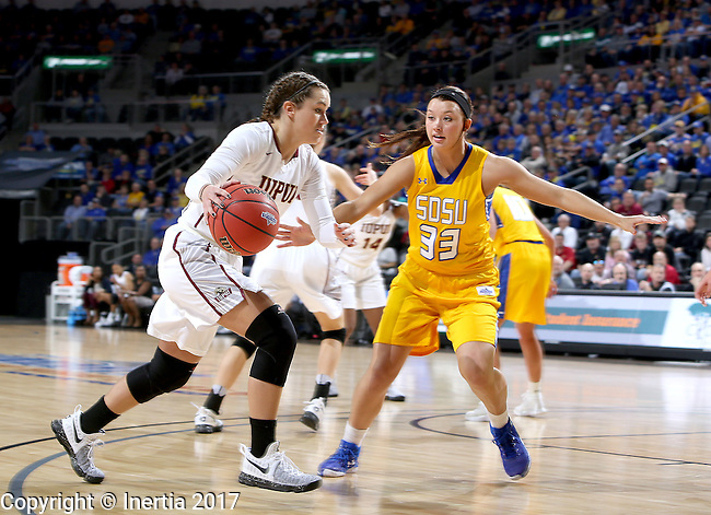 SIOUX FALLS, SD: MARCH 6: Kelsi Byrd #3 from IUPUI drives against Sydney Tracy #33 from South Dakota State during the Summit League Basketball Championship on March 6, 2017 at the Denny Sanford Premier Center in Sioux Falls, SD. (Photo by Dave Eggen/Inertia)