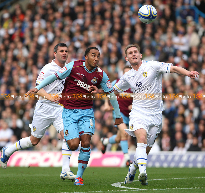 Nicky Maynard of West Ham gets in between Leeds pair Paul Robinson and Tom Lees - Leeds United vs West Ham United, npower Championship at Elland Road, Leeds - 17/03/12 - MANDATORY CREDIT: Rob Newell/TGSPHOTO - Self billing applies where appropriate - 0845 094 6026 - contact@tgsphoto.co.uk - NO UNPAID USE.