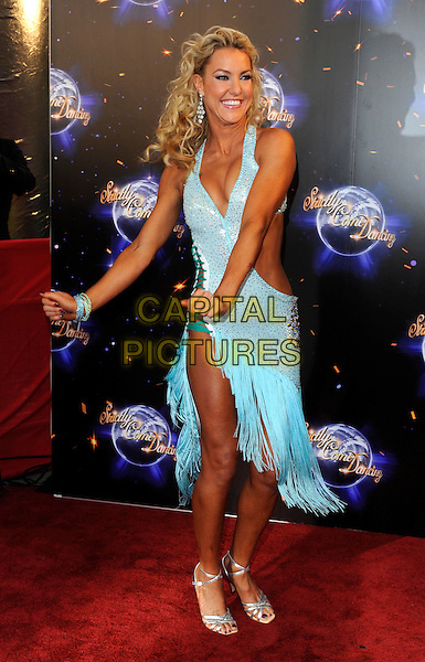 NATALIE LOWE.'Strictly Come Dancing' Launch Event at BBC Studios, London, England..September 7th 2011.full length blue dress cut out away hands arms dancing gesture .CAP/FIN.©Steve Finn/Capital Pictures.