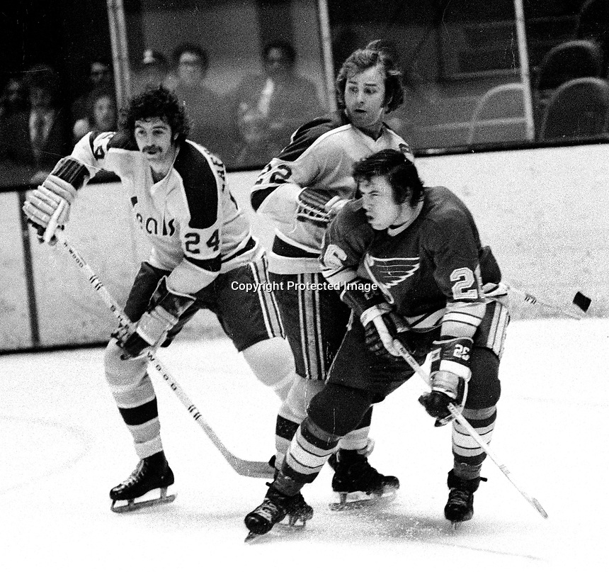 Seals vs St. Louis Blues...Pete Laframboise and Joey Johnston, with Blues Noel  Picard. (1972 photo/Ron Riesterer)