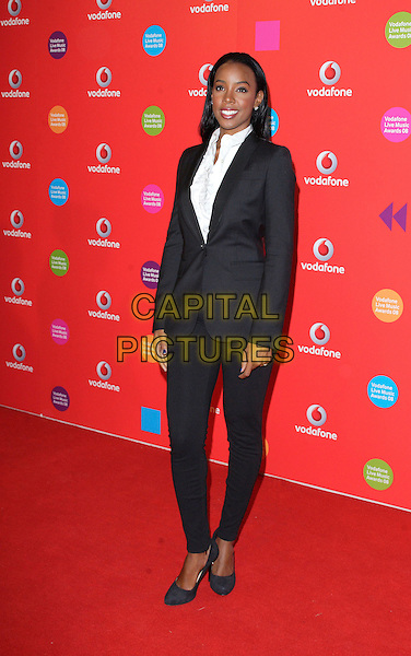 KELLY ROWLAND .Vodafone Live Music Awards 2008 at the Carling Academy, Brixton, London - September 18th 2008.full length black tuxedo jacket suit skinny trousers.CAP/ROS.©Steve Ross/Capital Pictures