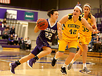 SIOUX FALLS, SD - DECEMBER 31: Mariah Szymanski #22 from the University of Sioux Falls drives to the basket against Naomi Rust #42 from Augustana University during their game Sunday afternoon December 31, 2017 at the Stewart Center in Sioux Falls. (Photo by Dave Eggen/Inertia)