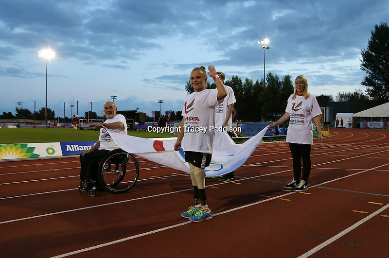 Monday August 18, 2014 <br /> Picture: IPC Flag Bearers<br /> RE: Flag Bearers carry the IPC flag around the track at the 2014 IPC Athletics European Championships Opening Ceremony held at the Swansea University Sports Village.