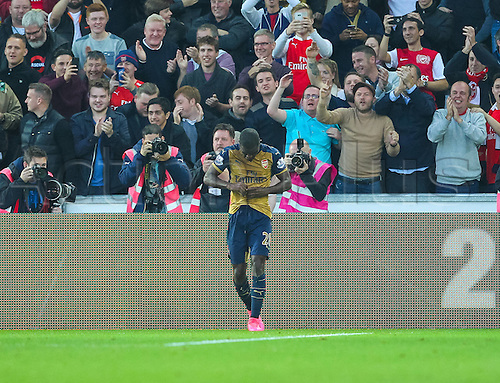 31.10.2015. Liberty Stadium, Swansea, Wales. Barclays Premier League. Swansea versus Arsenal. Arsenal's Joel Campbell scores Arsenal's third goal and the Arsenal fans celebrate