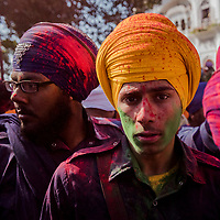 ANANDPUR SAHIB, INDIA - March 06, 2015: Young Nihangs, or &quot;Sikh warriors&quot;  look on after playing with color, as others (unseen) perform Gatka (mock encounters with real weapons) during Hola Mohalla celebrations on March 06, 2015 in Anandpur Sahib, India. Hola Mahalla or simply Hola is a Sikh event, which takes place on the first of the lunar month of Chet, which usually falls in March, and sometimes coincides with the Sikh New Year. It was started by Guru Gobind Singh the tenth Sikh guru in 1701 AD. Hola Mohalla is a three day Sikh festival, in which Nihang Sikh 'warriors' perform Gatka (mock encounters with real weapons), tent pegging and bareback horse-riding.<br /> Daniel Berehulak for The New York Times