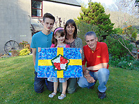 Pictured: Elly Neville (2nd L) with L-R brother Rhys, mum Anna and dad Lyn circa 2009 <br /> Re: Seven-year-old Elly Neville who was born despite doctors saying her parents would not be able to have any more children, has raised over £150,000 for the cancer ward that treated her father.<br /> Her parents Lyn and Ann had been told they were unlikely to have more children after he underwent a bone marrow transplant in 2005. <br /> Mr Neville subsequently spent a lot of time on the Ward 10 cancer facility at Withybush Hospital in Haverfordwest, Pembrokeshire.<br /> But four years later they were stunned when his painter and decorator wife Ann fell pregnant again.