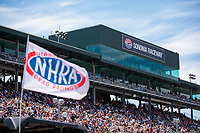Jul 29, 2018; Sonoma, CA, USA; An NHRA flag waves in front of the main grandstands during the Sonoma Nationals at Sonoma Raceway. Mandatory Credit: Mark J. Rebilas-USA TODAY Sports