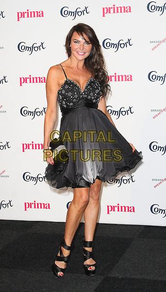 Lizzie Cundy.Prima High Street Fashion Awards, Battersea Evolutions, Battersea Park, London, England..September 8th, 2011.full length dress clutch bag black .CAP/JIL.©Jill Mayhew/Capital Pictures