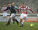 Accies Grant Gillespie is pulled back by Raith's Allan Walker.