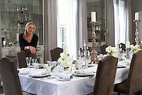 Christine Rucker in the dining room of her country house which is furnished with a custom-made table by Rupert Bevan