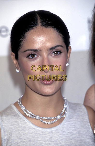 SALMA HAYEK.portrait headshot silver diamond stud earings necklace jewellery.Cannes Film Festival.May 1999.ww.capitalpictures.com.sales@capitalpictures.com.©Capital Pictures
