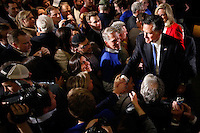 MITT ROMNEY greets a swarm of supporters at a campaign rally following the Iowa caucus Tuesday, January 3, 2012 in Des Moines, Iowa.