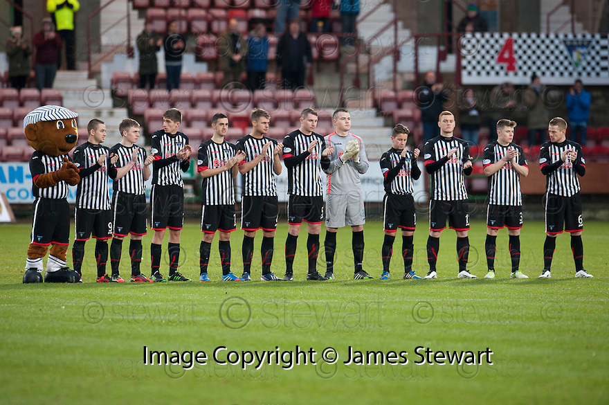 Dunfermline players during the minutes applause to celebrate the life of Nelson Mandela.
