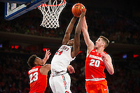 NEW YORK, NY - Sunday December 13, 2015: Kassoum Yakwe (#14) of St. John's goes up for a basket against Tyler Lydon (#20) of Syracuse as the two square off during the NCAA men's basketball regular season at Madison Square Garden in New York City.  St. John's would go on to win 84-72.