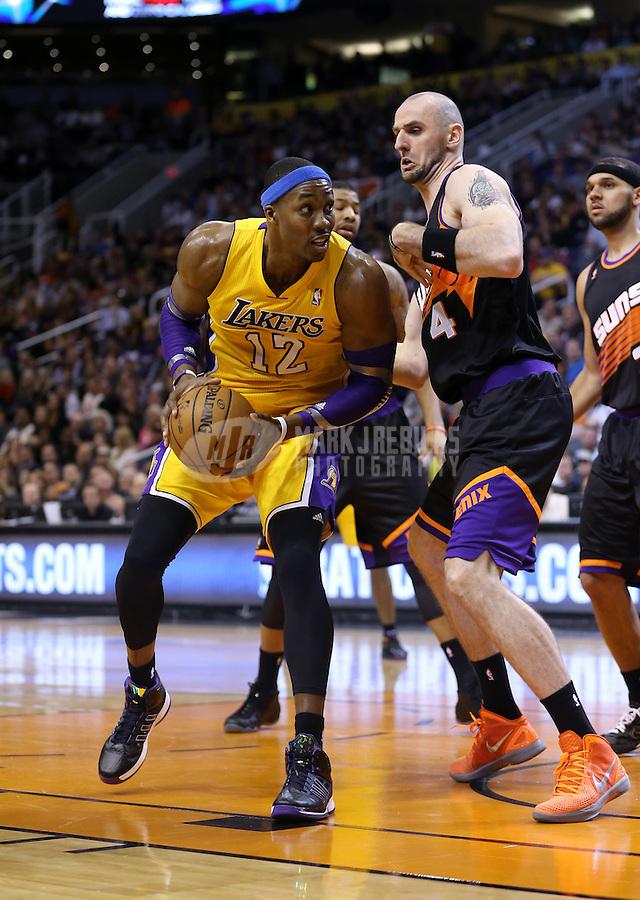 Jan. 30, 2013; Phoenix, AZ, USA: Los Angeles Lakers center Dwight Howard (12) against Phoenix Suns center Marcin Gortat (4) at the US Airways Center. Mandatory Credit: Mark J. Rebilas-