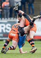 Picture by Allan McKenzie/SWpix.com - 11/03/2018 - Rugby League - Betfred Super League - Castleford Tigers v Salford Red Devils - the Mend A Hose Jungle, Castleford, England - Luke Burgess is upended by Oliver Holmes.