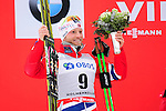 HOLMENKOLLEN, OSLO, NORWAY - March 16: Martin Johnsrud Sundby of Norway (NOR) celebrates his 2nd place during the prize giving ceremony of the Men 50 km mass start, free technique, at the FIS Cross Country World Cup on March 16, 2013 in Oslo, Norway. (Photo by Dirk Markgraf)