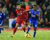 30th January 2019, Anfield, Liverpool, England; EPL Premier League football, Liverpool versus Leicester City; Nampalys Mendy of Leicester City wins the ball from Roberto Firmino of Liverpool