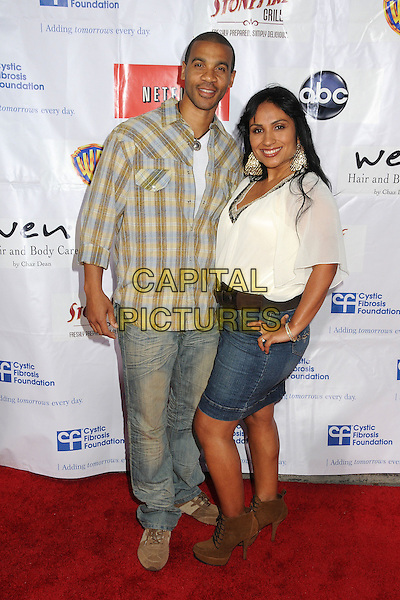 """Aaron D. Spears.""""Desperate Housewives"""" Wisteria Lane Block Party held at Universal Studios Backlot,  Universal City, California, USA,.21st April 2012. .full length checked shirt white top denim skirt jeans .CAP/ADM/BP.©Byron Purvis/AdMedia/Capital Pictures."""