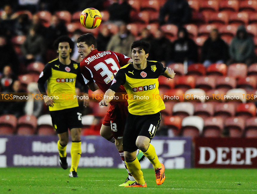 Fernando Forestieri of Watford battles with Richard Smallwood of Middlesbrough - Middlesbrough vs Watford - Sky Bet Championship Football at the Riverside Stadium, Middlesbrough - 09/11/13 - MANDATORY CREDIT: Steven White/TGSPHOTO - Self billing applies where appropriate - 0845 094 6026 - contact@tgsphoto.co.uk - NO UNPAID USE