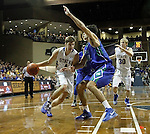 SIOUX FALLS, SD - NOVEMBER 30:  Jake Bittle #4 from South Dakota State University drives against Armand Shoon #4 from Florida Gulf Coast in the second half of their game Sunday afternoon at the Sanford Pentagon in Sioux Falls. (Photo by Dave Eggen/inertia)