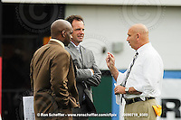 July 18, 2009; Hamilton, ON, CAN; Winnipeg Blue Bombers head coach Mike Kelly, right, speaks with TSN sportcaster Rod Black and TSN game analyst Duane Forde prior to the game against the Hamilton Tiger-Cats. CFL football: Winnipeg Blue Bombers vs. Hamilton Tiger-Cats at Ivor Wynne Stadium. The Tiger-Cats defeated the Blue Bombers 25-13. Mandatory Credit: Ron Scheffler. Copyright (c) 2009 Ron Scheffler.